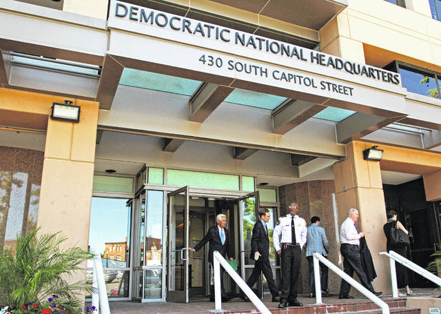 FILE - This Tuesday, June 14, 2016 file photo shows the entrance to the Democratic National Committee (DNC) headquarters in Washington. On Friday, Sept. 27, 2019, The Associated Press reported on stories circulating online incorrectly asserting that the FBI only relied on the word of a cybersecurity firm, CrowdStrike, to determine that Russia hacked the emails of the Democratic National Committee. CrowdStrike provided forensic evidence and analysis for the FBI to review during its investigation into a 2016 hack of DNC emails.