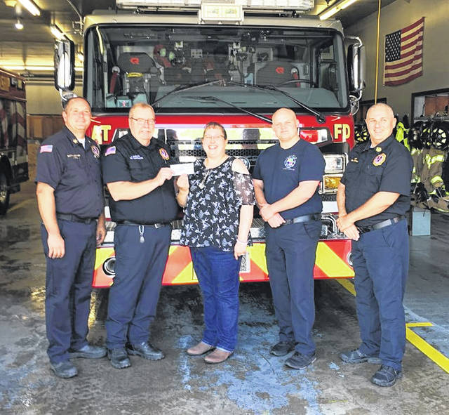 The American Township FireFighters Local 4020 made a $1,100 donation Monday to the Autism Life Center. Proceeds came from a T-shirt sale in March and April of this year. Pictured from the left are Batallion Chief Joel Will, EMS Coordinator Bob Rowland, Autism Life Center Tera Viola, FF/Medic BJ Shank and Chief Thomas Hadding.