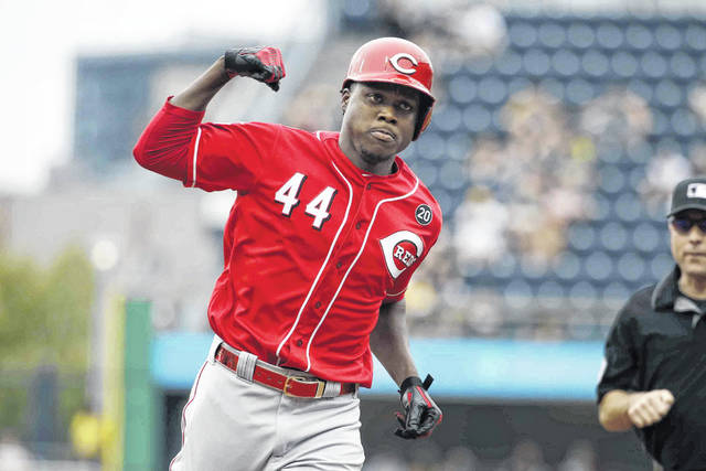 Cincinnati Reds' Aristides Aquino (44) rounds third base after hitting a solo home run off Pittsburgh Pirates starting pitcher Trevor Williams during the second inning of a baseball game in Pittsburgh, Sunday.