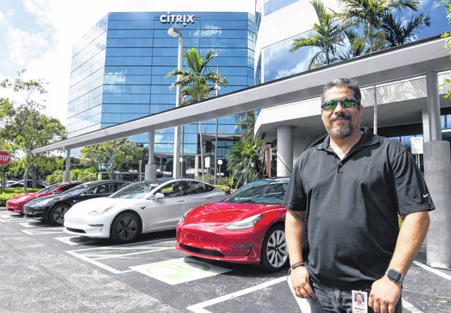 """Citrix Systems employee Rafael Santoni is so enthusiastic about Teslas that he saved for two years to buy one and founded the Tesla Club of South Florida to encourage other drivers to """"go electric."""""""