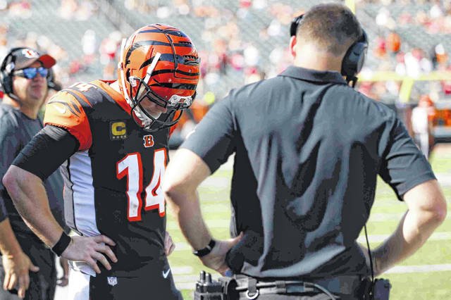 Cincinnati Bengals quarterback Andy Dalton (14) reacts alongside head coach Zac Taylor, right, after an NFL football game against the San Francisco 49ers, Sunday, Sept. 15, 2019, in Cincinnati. (AP Photo/Frank Victores)