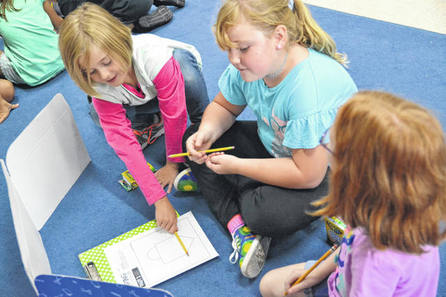 Students work collaboratively using critical thinking/problem solving at Crestview Elementary School.