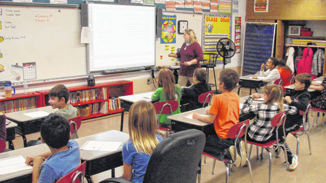 Third graders at Franklin Elementary School use a SmartBoard for an interactive lesson.