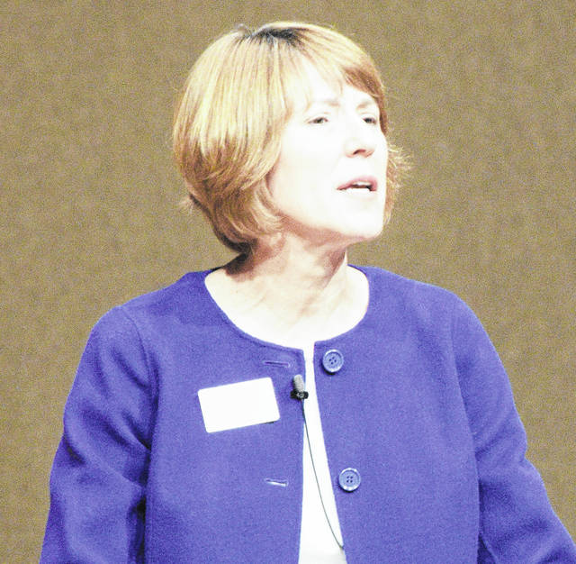 Dr. Jane Wood, president of Bluffton University speaks to students and faculty in Yoder Recital Hall.