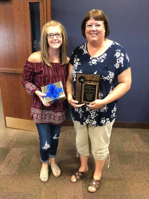 The Allen County Board of Developmental Disabilities recognized employees Tammy DeLong, left, and Chris Calvelage, right, for supporting people with developmental disabilities in the community.