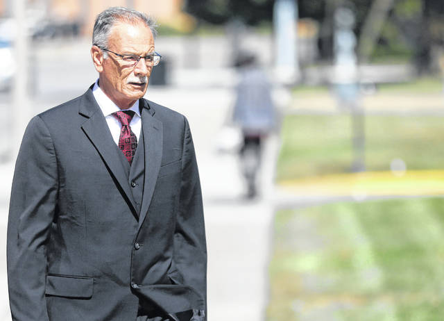 Samuel Crish, former sheriff in Allen County, arrives at U.S. District Court for the Northern District of Ohio in Toledo on Thursday. He was sentenced to more than 11 years in federal prison after pleading guilty in March in an extortion and bribery case.