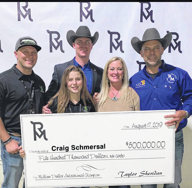 "Craig Schmersal and his family celebrate with a big check after his win at the ""Run For A Million"" horse reining competition, where he split his winnings with the other winner. Front row from left are his son, Chris, daughter, Addie, and wife, Ginger, and back row, his son, Nick."