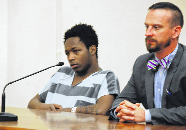 Lima resident Demondtray Burns, 19, appeared in court Tuesday to request a new court-appointed attorney. Carroll Creighton, right, his initial court-appointed attorney, agreed that communication between the pair had broken down. Burns is charged with aggravated robbery for reportedly stealing a cell phone from a female at gunpoint.