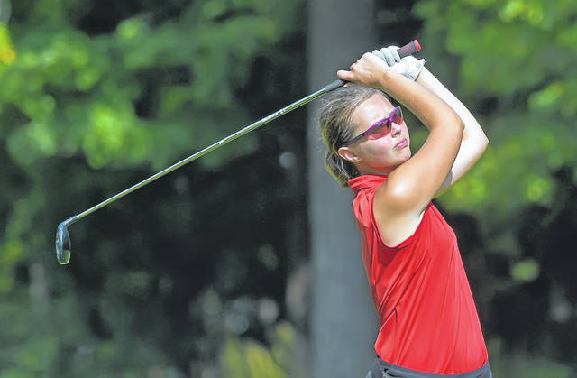 St. Henry's Ellen Naumann watches her tee shot on the 18th hole during Monday's Division II District Tournament at Sycamore Springs Golf Course.