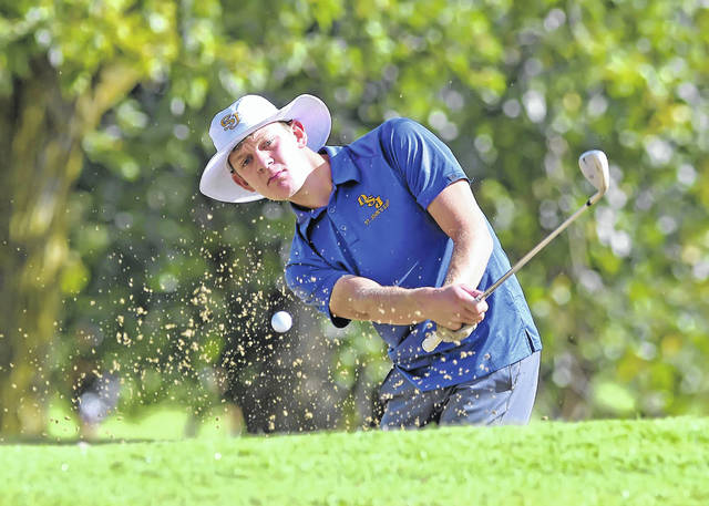 Jared Lucas of Delphos St. John's hits out of the sand on the eighth hole during Thursday's Division III sectional at Colonial Golfers Club in Harrod.