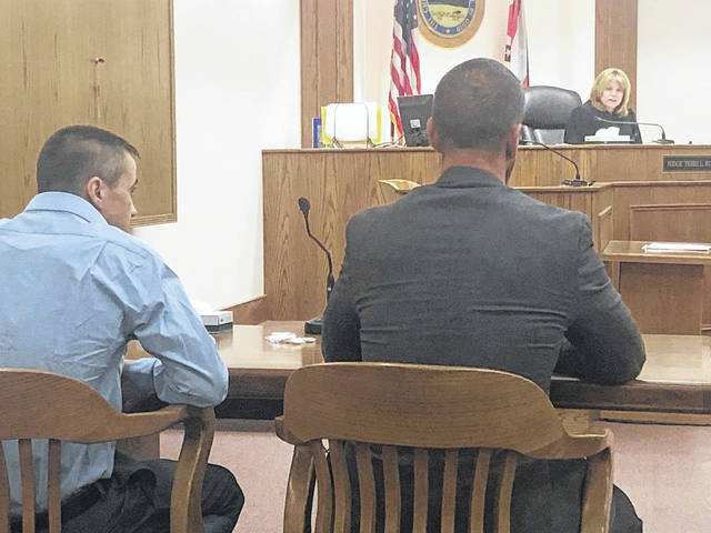 Judge Terri Kohlrieser reads the jury's verdicts as defendant Karl Duncan and his attorney, Carroll Creighton, look on Thursday morning in Allen County Common Pleas Court. Duncan was convicted of domestic violence, while jurors were unable to reach a verdict on a charge of kidnapping against the Alger man.