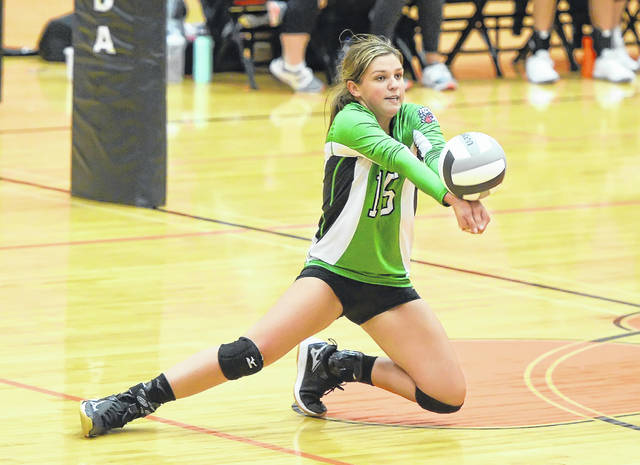 Celina's Brooklyn Bourne makes a dig during Thursday night's match at Elida.