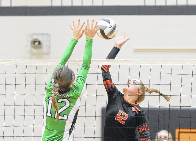 Elida's Rachel Mitchell hits a spike against Celina's Maria Lutz during Thursday night's match at Elida.