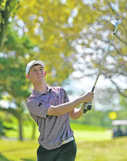 Kalida's Josh Recker watches his shot on the tenth hole during Monday's PCL meet Moose Landing Country Club.