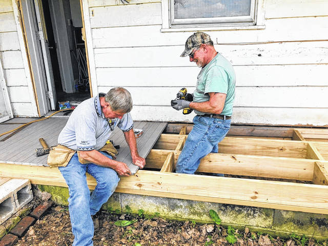 "From left are Jerry Hanneman and Vincent ""Doc"" Eickholt, Habitat For Humanity of Putnam County volunteers, working on a porch for a rural Continental project."
