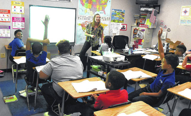 Amy May teaches fifth-grade math at Heir Force Community School in Lima.