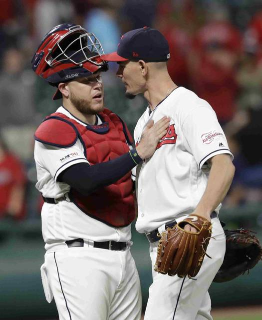 Cleveland Indians' Roberto Perez, left, congratulates relief pitcher Nick Wittgren after the Indians defeated the Chicago White Sox 8-6 in a baseball game Wednesday in Cleveland. (AP Photo/Tony Dejak)