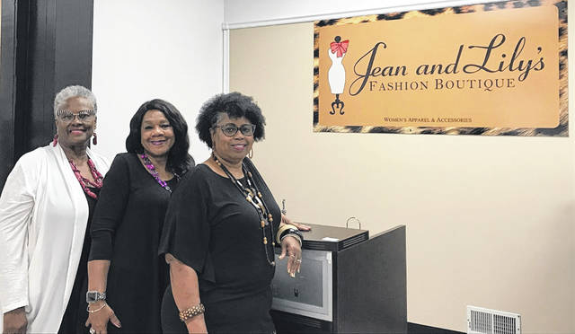 Ethel Newby (left), Linda Hampshire and Sharon Guice show off the new Jean & Lily's storefront, now found at 220 N. Main St.