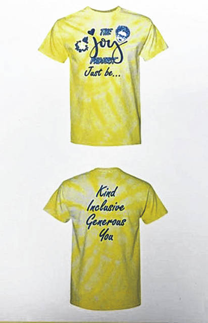 "Lima Senior High School DECA students are selling special The Joy Project shirts and sweatshirts. The front says ""Just Be…"" and the back says ""Kind, Inclusive, Generous, You."""