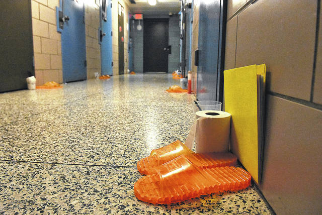 Inmates flip-flops and hygiene items placed outside cells at the Allen County Juvenile Detention Center. Craig J. Orosz | The Lima News