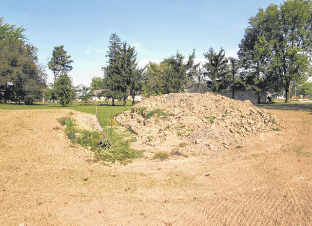Pictured is a piece of land adjacent to the home of Kalida's Edward and Michelle Knueve, who live at 157 Walnut St., Kalida. The couple has filed a lawsuit against the village of Kalida stating the project does not have a development plan and is causing damages with flooding to their home.