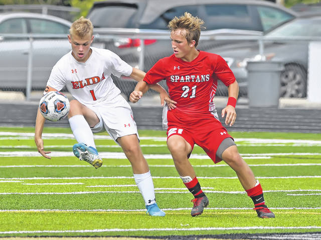 Elida's Draek Littler dribbles against Lima Senior's Aaron Bowsher during Saturday's match at Spartan Stadium.