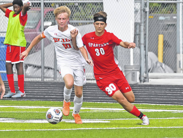 Elida's Tyler Long, left, and Lima Senior's Caden Fry compete for the ball during Saturday's match at Spartan Stadium.