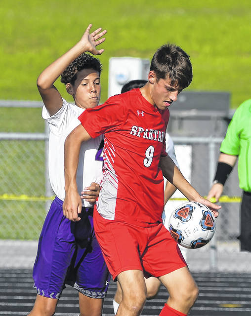 Lima Senior's Noah Phillips controls the ball against Fremont Ross' Ayden Carter during Tuesday's match at Spartan Stadium.