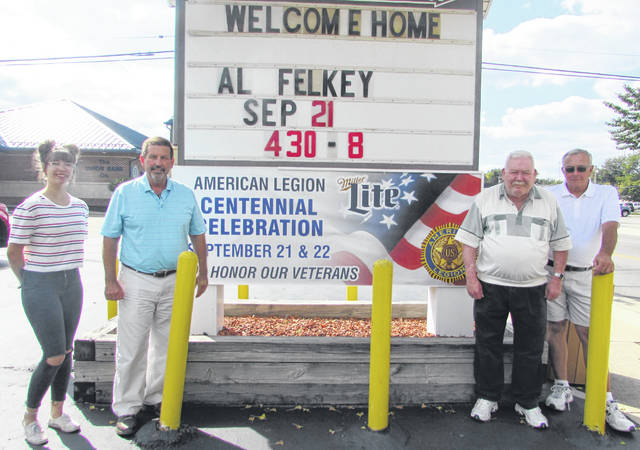 Kerner-Slusser American Legion Post 63 in Ottawa will celebrate its centennial with a two-day event Sept. 21 and 22. From left are Brooke Langhals, videographer; Dave Kersh, Legion historian; Brent Deskins, legion first vice commander; and Ed Foreman, Legion commander.