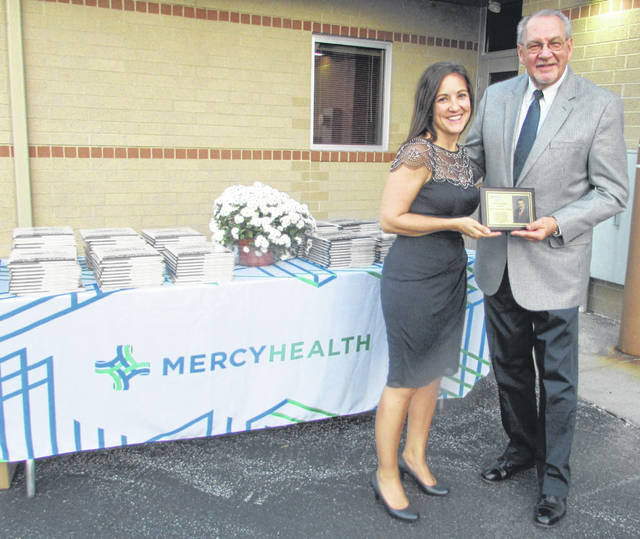 From left are Ronda Lehman, Mercy Health-Lima Market president, and Dr. John Snyder, Mercy Club Award recipient.