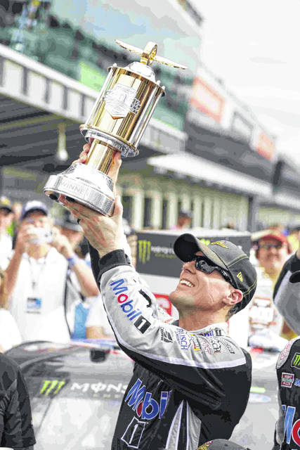 Kevin Harvick celebrates after winning the NASCAR Brickyard 400 auto race at Indianapolis Motor Speedway, Sunday, Sept. 8, 2019, in Indianapolis. (AP Photo/Michael Conroy)