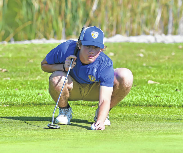 Lincolnview's Landon Price lines up a putt on the eighth green during Thursday's Northwest Conference tournament at Bluffton Golf Club.