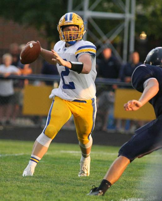 St. Marys quarterback Kurt Bubp looks for an open receiver during Friday night's game at Ottawa-Glandorf. Jose Nogueras | The Lima News