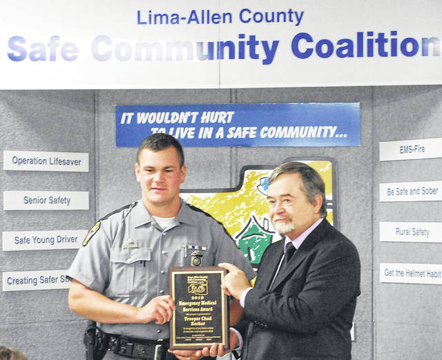 Trooper Chad Recker of the Lima post of the Ohio State Highway Patrol was among the individuals, businesses and agencies honored Thursday by the Lima Allen-County Safe Community Coalition and the the Fraternal Order of Police Lodge and its auxiliary. Lima Municipal Court Judge David Rodabaugh presented the awards.