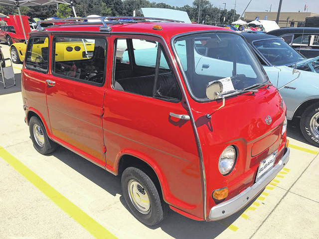 """Ken and Vicki Siefker, of Delphos, own this 1970 Subaru Micro Van. They enjoy driving with other """"micro people."""""""