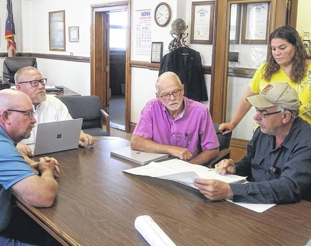 Pictured clockwise from left looking over plans for moving the Putnam County Recycling Center are commissioners John Schlumbohm, Michael Lammers, and Vincent Schroeder, Alaina Siefker, commissioner's secretary and Joe Hohlbein, recycling center director.