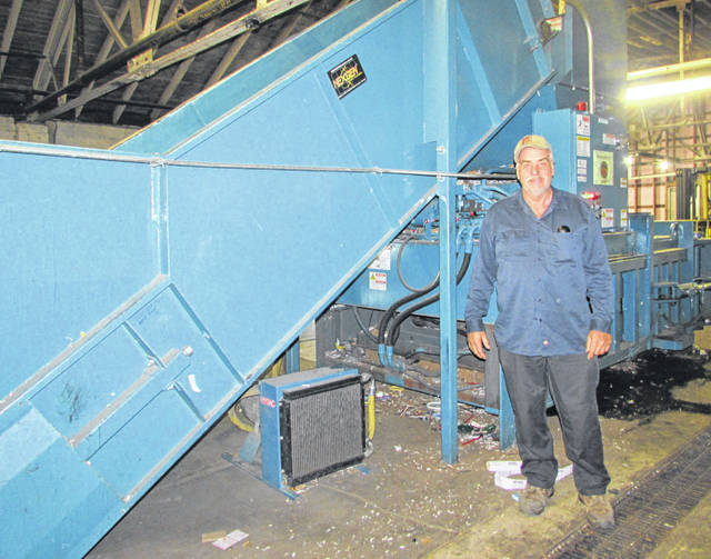 Joe Hohlbein, Putnam County Recycling Center, stands next to a recycling baler Thursday at the existing facility that will be moved to another building.