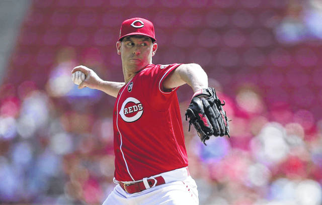 Cincinnati Reds starting pitcher Anthony DeSclafani throws against the Philadelphia Phillies during the first inning of a baseball game, Monday, Sept. 2, 2019, in Cincinnati. (AP Photo/Gary Landers)