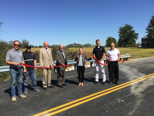 Pictured from left are Kyle VanTilburg and Jacob Waterman, of VTF Excavation; Mercer County commissioners Rick Muhlenkamp and Jerry Laffin; State Rep. Susan Manchester; Mercer County Commissioner Greg Homan and Mercer County Engineer Jim Wiechart.