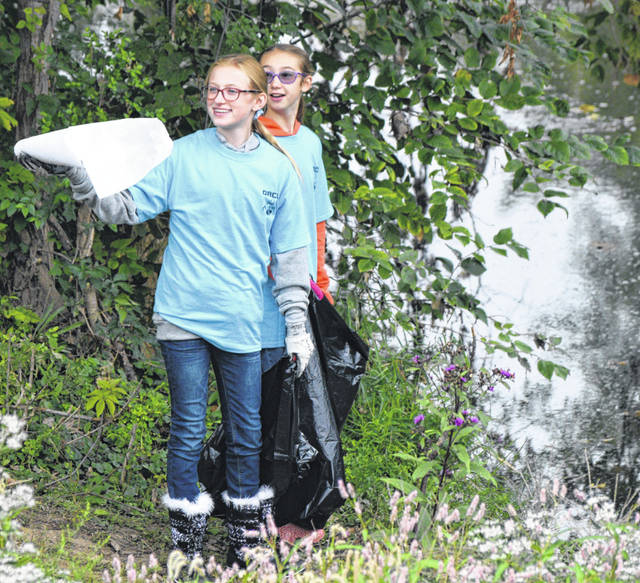 Samantha Strange and Amaris Walters helped clean up the Ottawa River on Saturday.