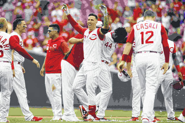 Cincinnati Reds' Michael Lorenzen, center, celebrates after hitting a game-winning RBI double off Arizona Diamondbacks relief pitcher T.J. McFarland in the ninth inning of a baseball game, Sunday, Sept. 8, 2019, in Cincinnati. (AP Photo/John Minchillo)