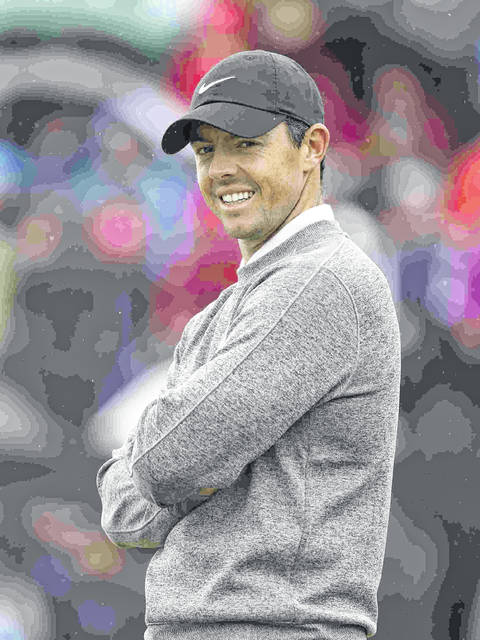 FILE - This is a July 19, 2019, file photo showing Northern Ireland's Rory McIlroy smiling on the first green during the second round of the British Open Golf Championships at Royal Portrush in Northern Ireland. McIlroy has been voted PGA Tour player of the year over Brooks Koepka after posting the most top-10 finishes and winning the FedEx Cup. It's the third time McIlroy has won the Jack Nicklaus Award, and the first without having won a major. (AP Photo/Jon Super, File)