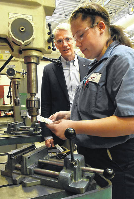 U.S. Senator Rob Portman, R-Ohio, talks with Jordan Moening, 16, a precision machining student, while touring Vantage Career Center on Wednesday. During the tour, Portman met with Vantage leadership to discuss career and technical education and how his bipartisan JOBS Act legislation will help more Ohioans get the skills and training they need to find in-demand jobs.