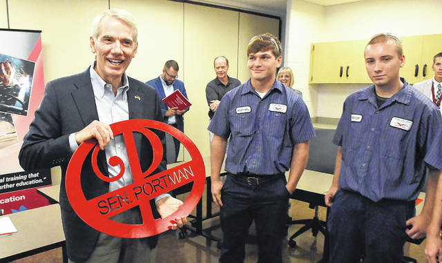 U.S. Sen. Rob Portman, R-Ohio, accepts a gift made from cut steel by precision machining students before touring Vantage Career Center on Wednesday.
