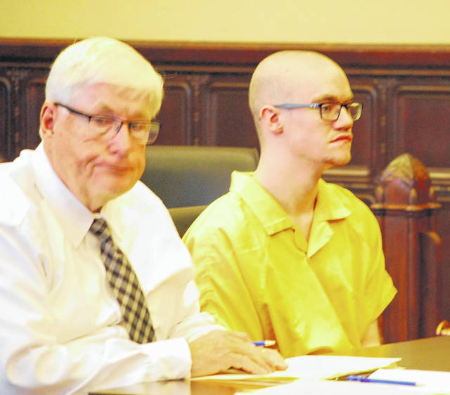 Wesley Slaughter, pictured with his attorney, Gerald Siesel, appeared briefly in Auglaize County Common Pleas Court on Friday. Slaughter's sentencing on four counts of arson in connection with a fire at a downtown Wapakoneta apartment building in December, was postponed until Oct. 3.