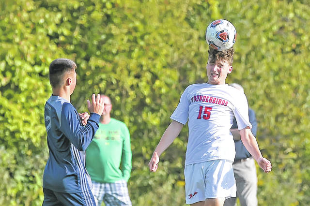 Lima Central Catholic's Austin Hatcher heads the ball in front of Temple Christian's Joshua Engle during Tuesday's match at Temple Christian.