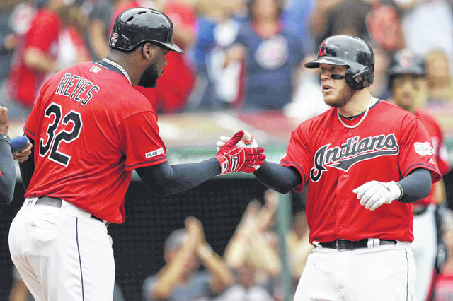 Cleveland Indians' Roberto Perez, right, is congratulated by Franmil Reyes after hitting a three-run home run in the sixth inning in a baseball game against the Minnesota Twins, Sunday, Sept. 15, 2019, in Cleveland. (AP Photo/Tony Dejak)
