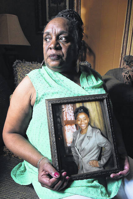 Vicki Williams holds a photograph of her daughter Leneshia, 17, who was murdered 18 years ago. Her daughter's killer, Cleveland Jackson, remains on Ohio's death row.