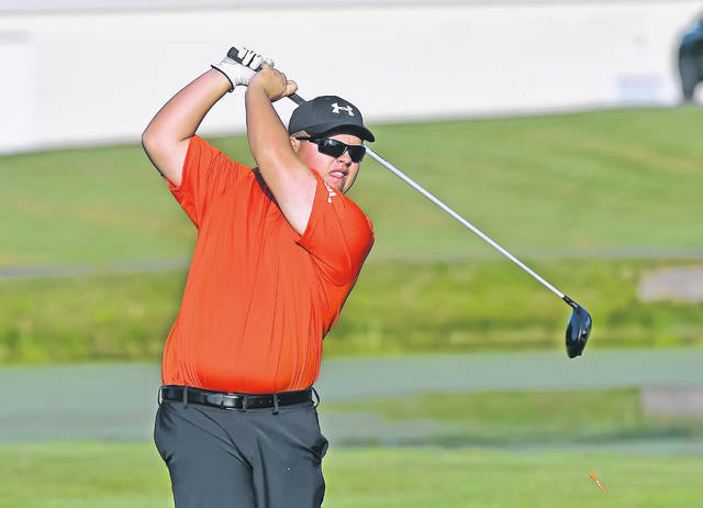 Elida's Ethan Harmon watches his tee shot on the first hole during Thursday's Western Buckeye League tournament at Tamarac Golf Course.