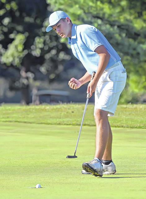 Bath's Britton Hall reacts to his putt going into the cup on the 13th hole during Thursday's Western Buckeye League tournament at Tamarac Golf Course.